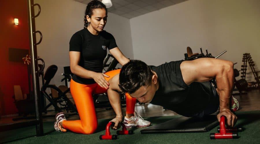 woman kneeling beside man